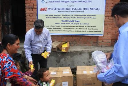 Photos of aid being distributed at the Mandali Devi Primary School in Nepal